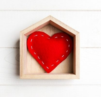 sewn heart in a house