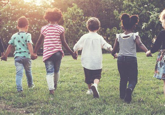 children running in a field