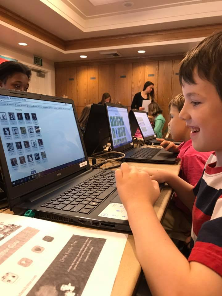 kid doing genealogy at a computer